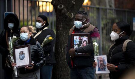 Nurses and health workers mourn and remember their colleagues who died from the new coronavirus during a demonstration outside Mount Sinai Hospital in Manhattan in New York City. (Photo: AFP / Johannes Eisele)