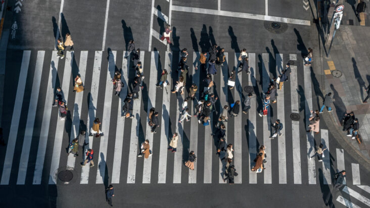 Aerial Crowd Japanese Pedestrian Crossing Street With Sunset Light Elevated View Asian People Walking Busiest Road Intersection Tokyo City