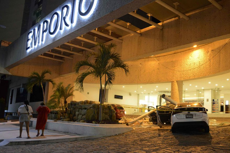 A Car Is Damaged By Lightning Strikes As People Stand Outside A Hotel After The Earthquake In Acapulco Guerrero State