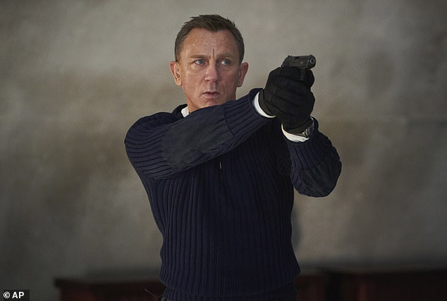 Daniel Craig Left And Ana De Armas In A Scene From No Time To Die 2